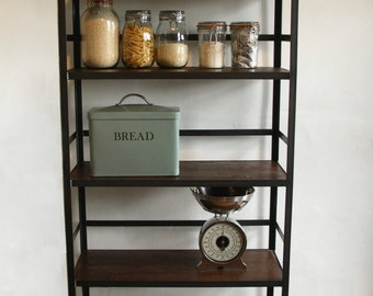 Industrial style shelving unit with retaining bar.