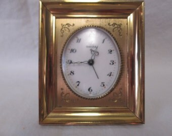 Antique Swiz Swiss Brass 8 day Alarm Clock on stand Etched detail in Brass Heavy
