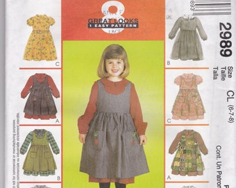 McCalls 2989 is NEW AND UNCUT in sizes 6-7-8 for young girls dress and pinafore