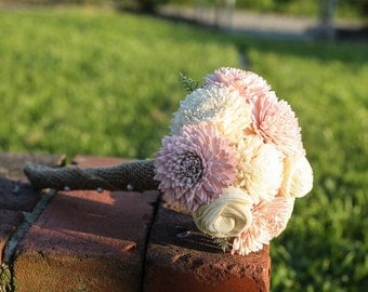 Small pink and cream sola bouquet wrapped in burlap.