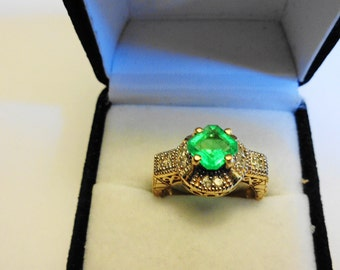 Natural Emerald & Diamonds in a 14kt. Gold Ring.