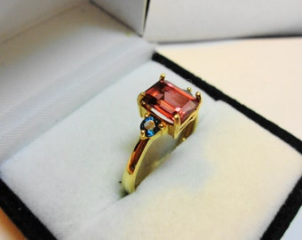 Tourmaline Ring 14kt.  Neon Tourmaline set in 14k gold with London Blue topaz accents.