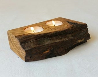 Candle holder in olive wood.