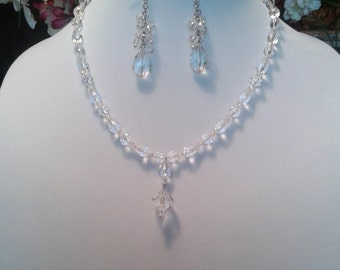 Crystal necklace and earring jewelry set. Sparkling clear crystal beads, silver tone clasp, necklace has a hanging Y extension