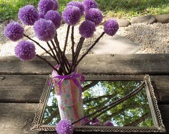 Purple yarn rustic pom pom flowers