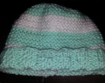 Green and white striped knitted baby hat