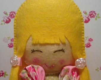 Mini felt doll