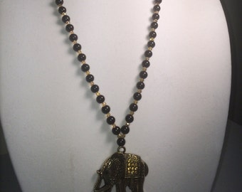 Black and bicone beads with Elephant Amulet
