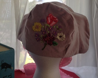 A one of a kind, hand embroidered baby bonnet.