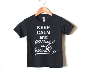 Keep Calm and Carry a Wand. Funny T Shirt. Kids T Shirt. Halloween Shirt. Sizes 2T-Youth 12. MADE TO ORDER