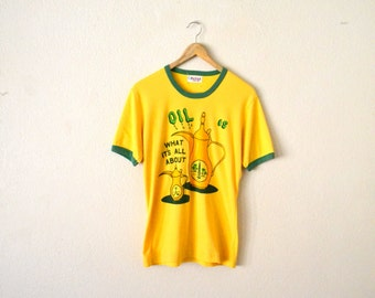 """1970's """"Oil Is What its All About"""" Graphic T-Shirt."""
