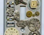 Steampunk Light Switch Cover With Vintage Watch Parts and Skunk Charm