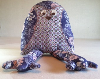 This soft little owl is the cutest stuffed animal ever! This unique handmade item is a great gift as a toy for a child or for a collector!