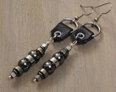 Bigshot earrings: black leather, stainless steel, hematite, pyrite, copper