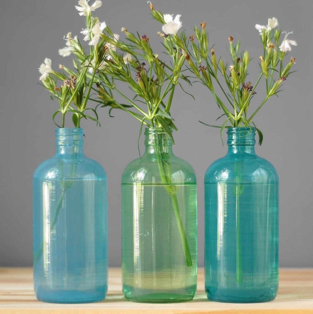 Seaside decor colored glass bottles set of three hand by for Colored bottles for decorations