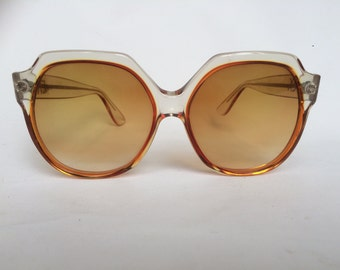 Vintage oversize Emmanuelle Khanh sunglasses.Honey colored glasses.