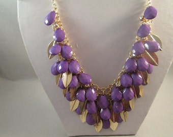 3 Row Bib Necklace with Purple Teardrop Beads and Gold Tone Leaf Beads on a Gold Tone Chain