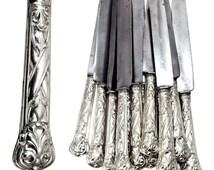 A Set of 12 Italian Silver Dinner Knives..