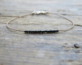 Black spinel bracelet. Minimalist black spinel bracelet. Micro rondelles spinel on brown silk thread