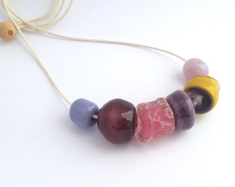 Lampwork beaded necklace- handmade glass beads in pink, purple and yellow