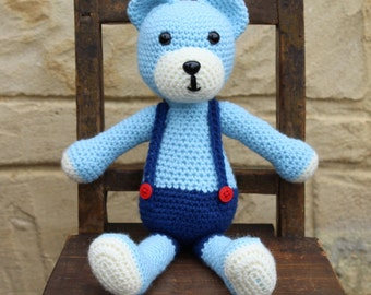 Handmade, crocheted toy teddy bear for children and babies in light blue, dark blue and cream