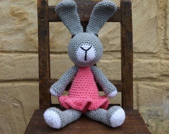 Handmade, crocheted toy rabbit for children and babies in grey, pink and white