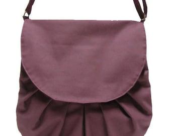 Burgundy waterproof handbag by Loli