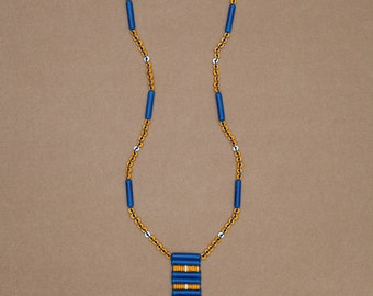 "Long beaded talisman necklace with cross pattern fringe in yellow, blue & white ceramic beads. ""Ella"" from the Midnight Collection"