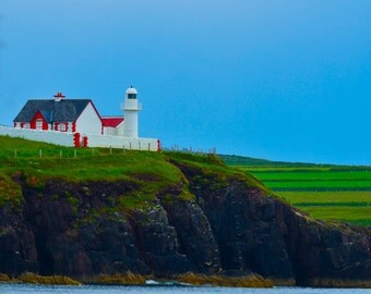 Colorful Ireland House on a Cliffside Hill
