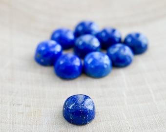 6mm lapis lazuli smooth cabochon. Dark blue cab. Blue and gold