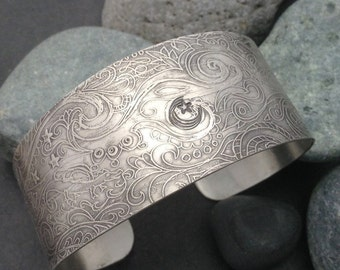 Wide cuff bracelet, solid sterling silver art jewelry with an abstract delicate flowing pattern  with leaves, vines, flowers, moon and stars