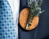 Rustic wooden boutonnieres with leather strapping