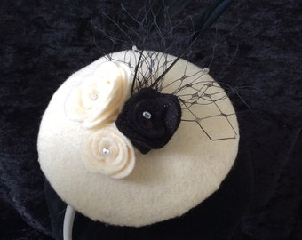 Cream and black felt fascinator
