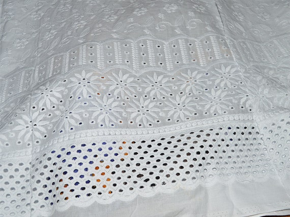 White eyelet embroidered cotton fabric by indianlacesandfabric