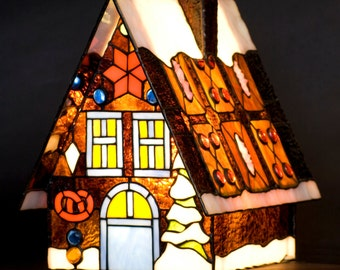 Christmas decoration xmas gingerbread stained glass house. Christmas decor. Gingerbread house. Small house with snow, mountain house.