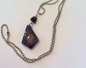 Black and gold pendent necklace