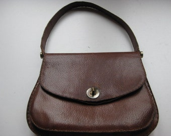 French small brown leather handbag with lots of pockets inside and a little wallet.