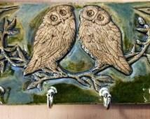Ceramic Celtic owls key tidy in a moss green glaze.