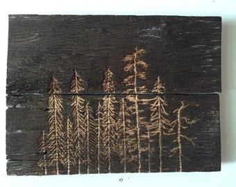 Pine tree forest on reclaimed fence wood, carved
