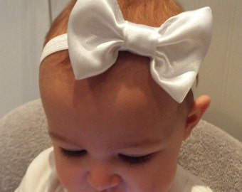 White satin 3 inch bow on a white soft elastic headband baby, toddler or girls new