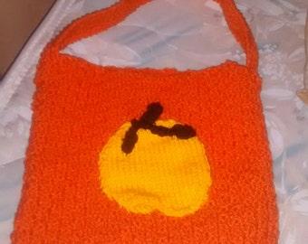 Orange pumpkin bag for candy supply