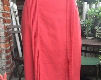 Coral-coloured skirt-geranium. Vintage. Pleated front. As 42-44