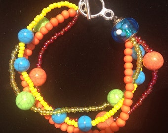 Colorful multi strand multi colted beaded bracelet - green, blue, orange, pink, yellow