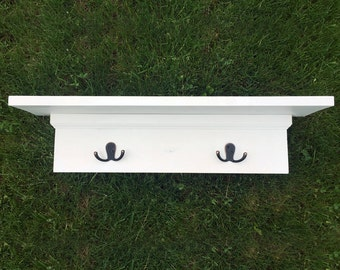 White Wooden Shelf with Hooks