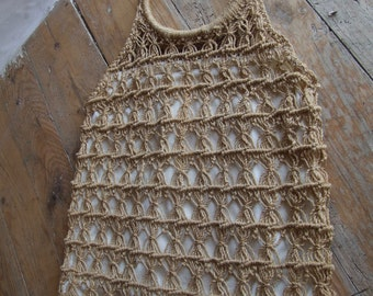 Stunning example of a woven shopping bag, with bamboo handles