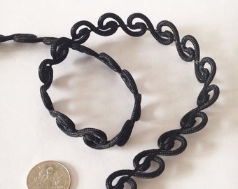 """Black Gimp Victorian trim, rayon, 1/2"""" wide. Offering it in 12-yard increments."""