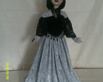 Victoria,an individually sculpted art doll.Paperclay head,painted in acrylics,cloth body