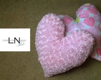 One heart shaped decorative pillow.