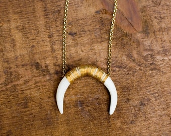 Bone tusk necklace