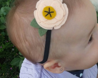 Poppy felt flower headband in peach and gold